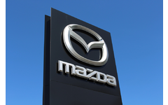Automobile manufacturer Mazda's logo on a sign