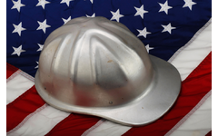 Silver construction hat on American Flag