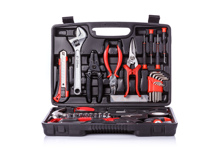 Open toolbox full of hand tools.