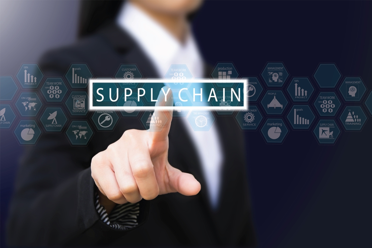 Business man touching supply chain icon.