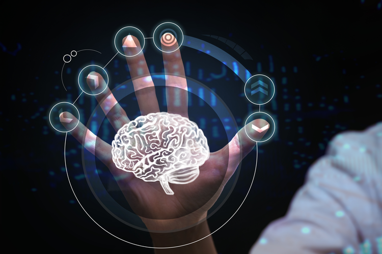 Hand on a virtual interface of futuristic medical technology showing a brain scan.