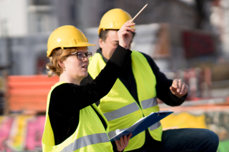 Woman directing team members on construction site