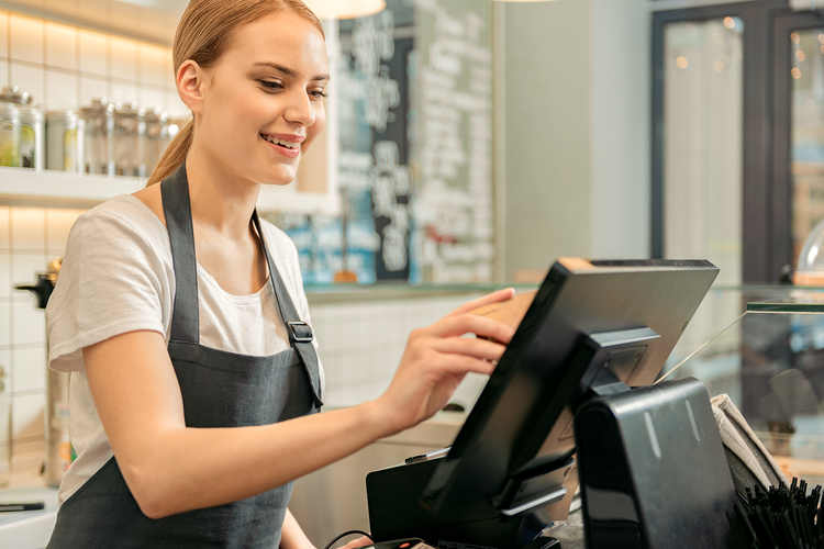 Young female cashier