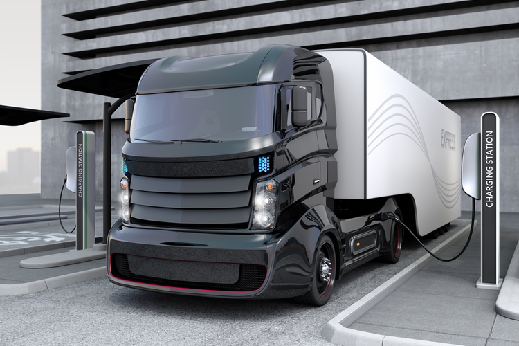 Electric hybrid truck at charging station