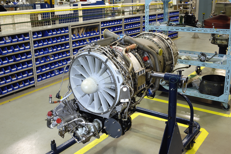 Aircraft engine on a stand in a manufacturing facility