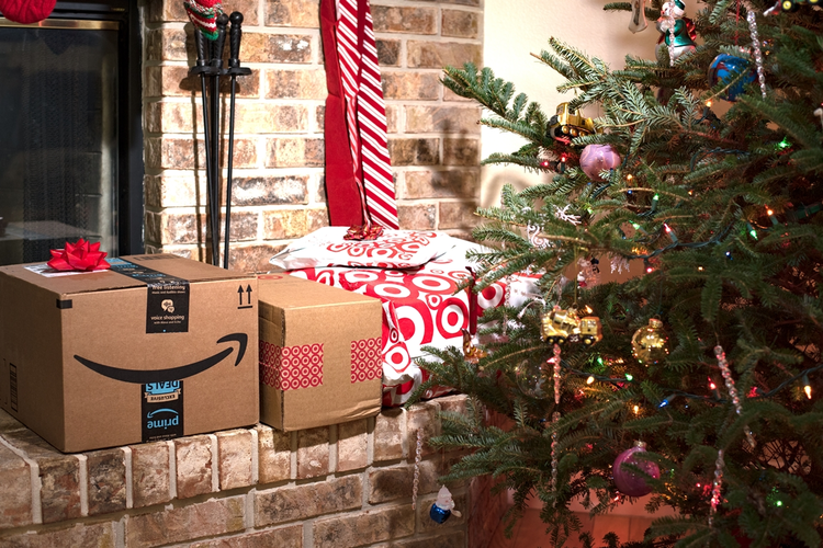 Amazon Prime and Target boxes by fireplace next to Christmas tree