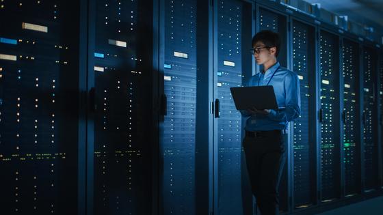 IT person in dark server room