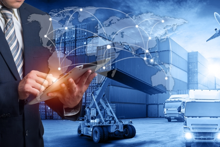 Man using tablet with images of supply chain processes in the background