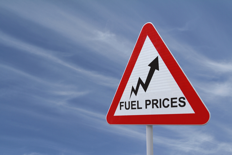 Road sign showing increasing fuel prices
