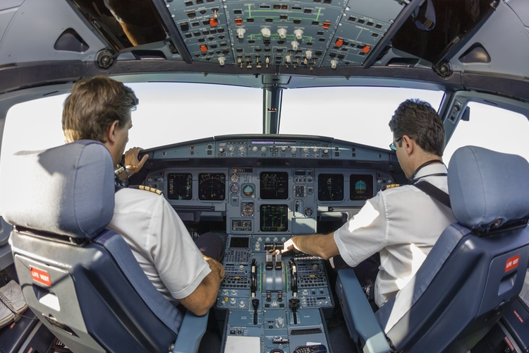 Pilots in an airplane cockpit.