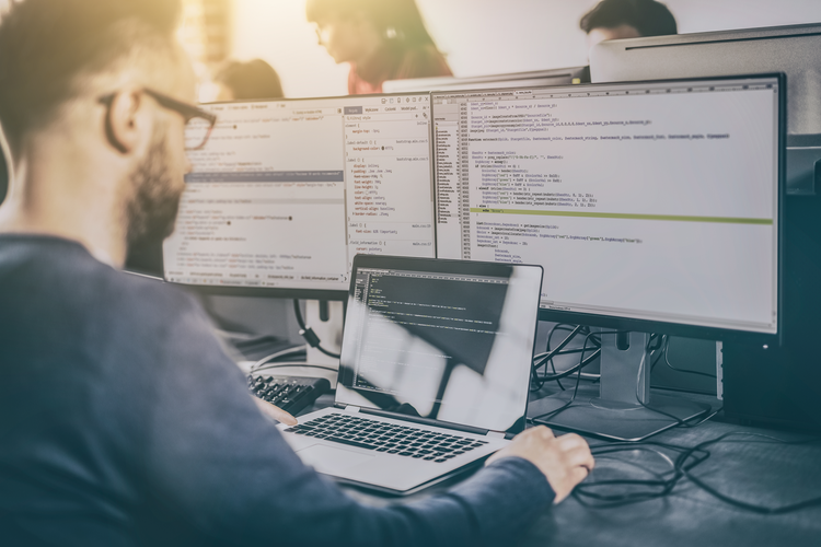Developer programming and coding on a computer