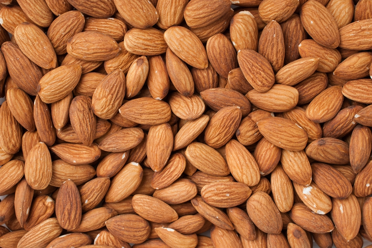Close-up image of peeled almonds.
