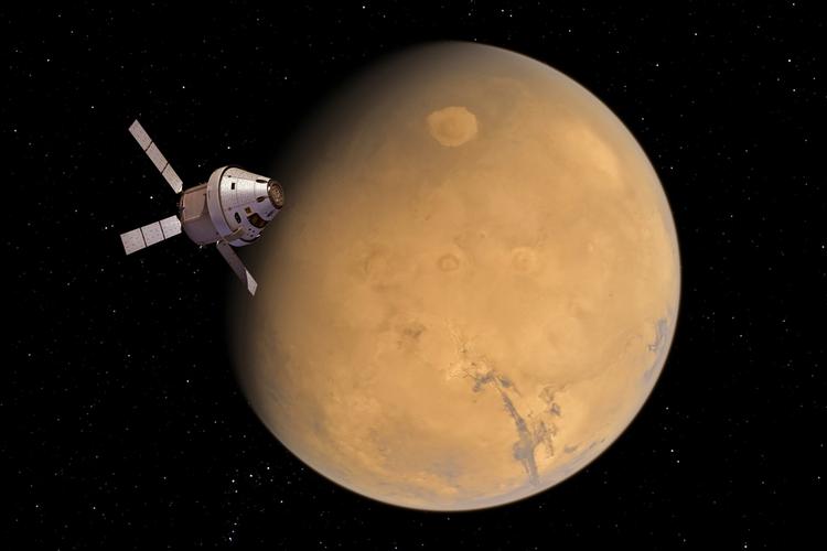 Spaceship Orion near Mars.