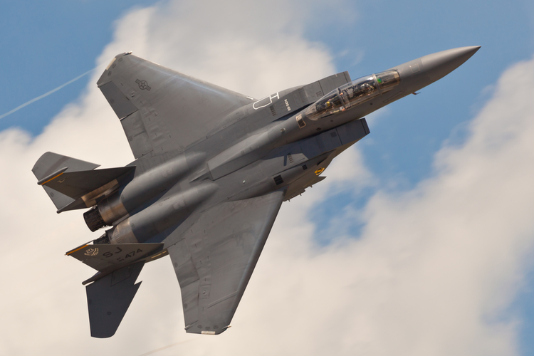 Boeing F15 Eagle fighter jet in flight with clouds in background