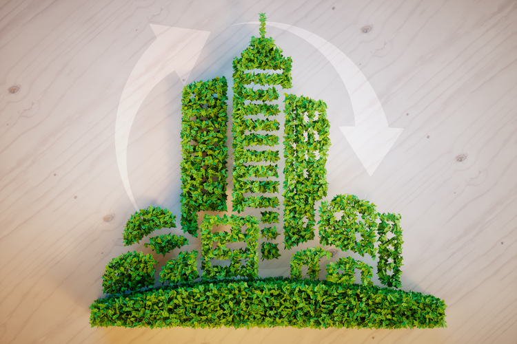 Green foliage in the shape of skyscrapers representing sustainability building/construction