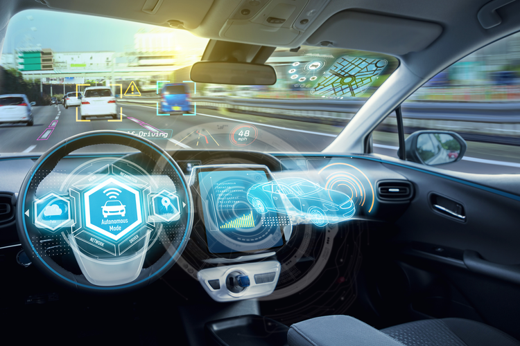 Interior of car with graphics overlaid representing autonomous driving capabilities