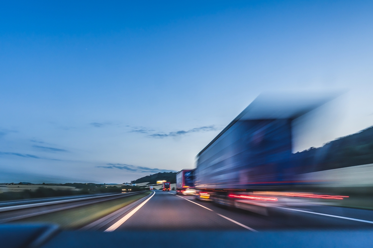 Blurred image of a delivery truck.