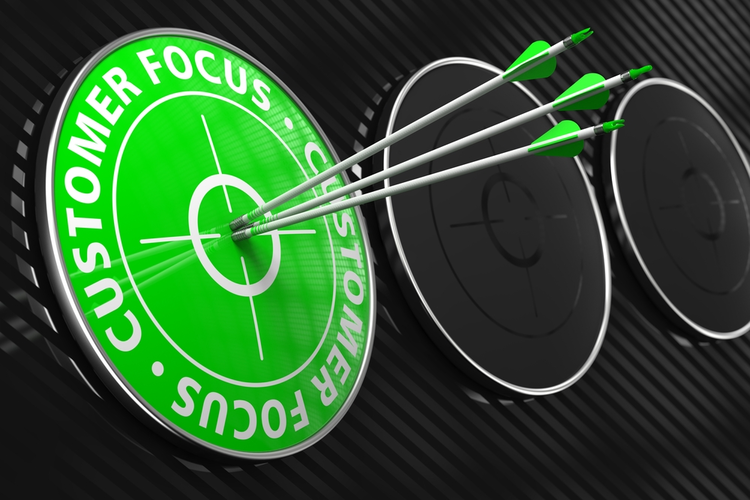 Three arrows hitting the center of a green target that says