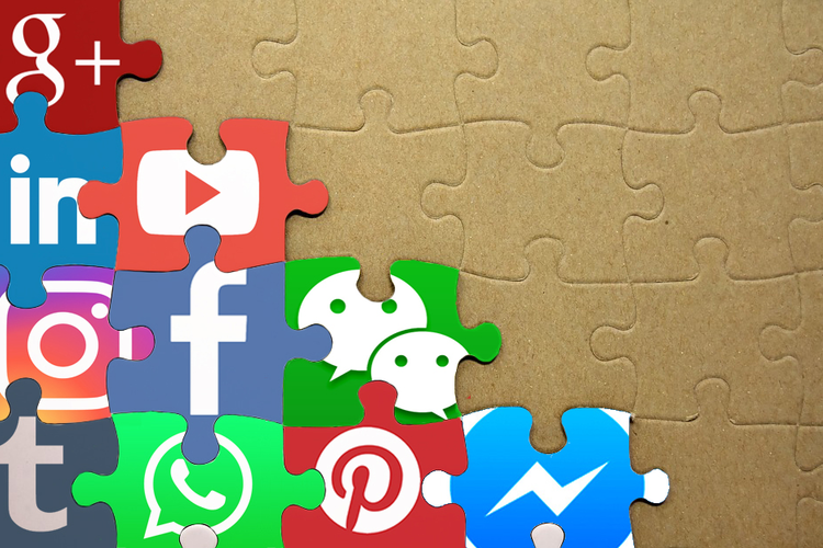Social media icons stacked into puzzle pieces