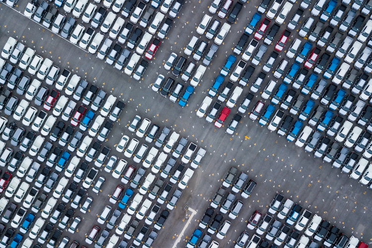 Cars lined up at a port.