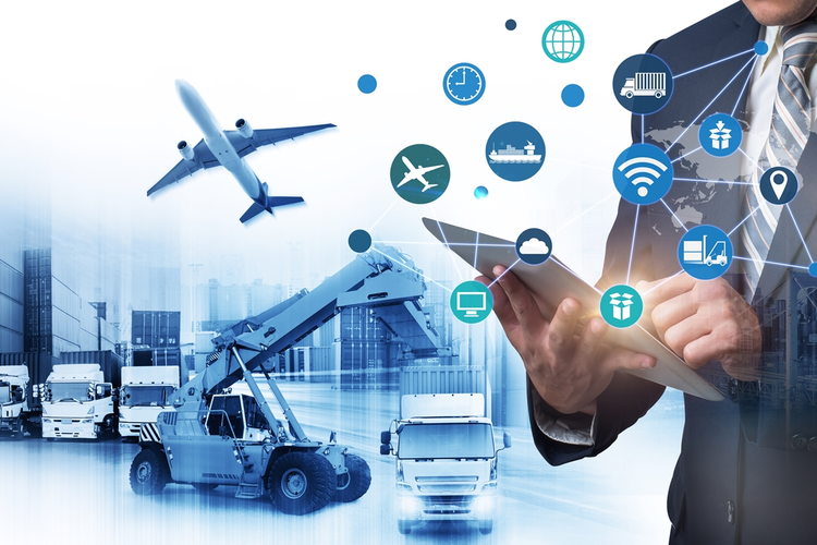 Man using tablet with logistics hub in background and graphics overlaid representing supply chain concepts