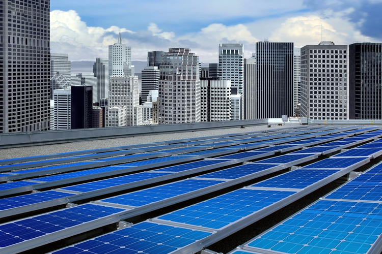 Solar panels on the roof of a modern skyscraper.