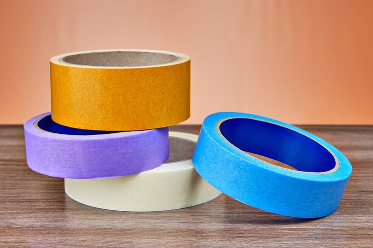 Rolls of multi-colored adhesives.