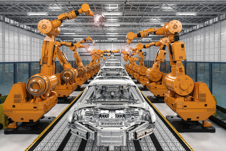 Robotic arms in a production line at an automotive manufacturing factory