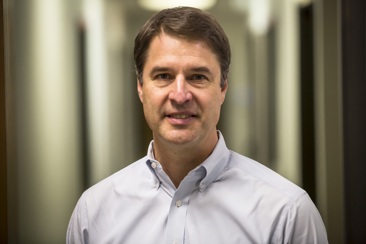 Headshot of Paul Ryznar - founder, president, and CEO of OPS Solutions