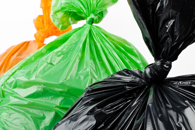 Orange, green, and black plastic trash bags