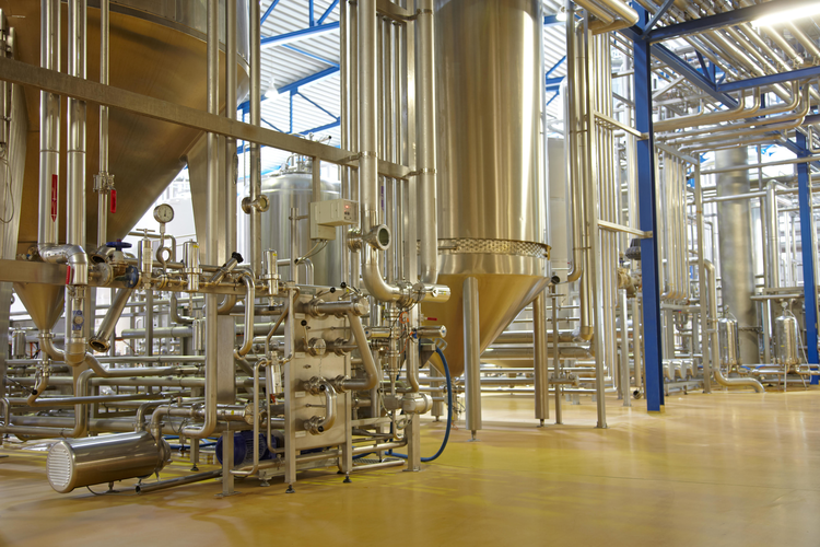 Piping systems and vats in a brewery.