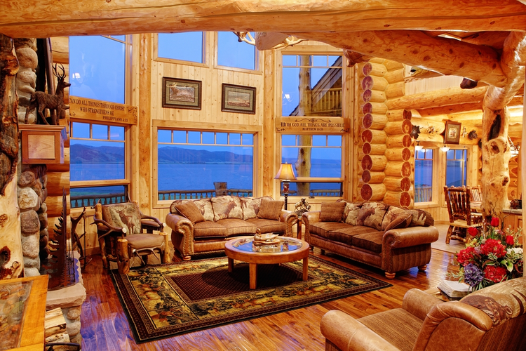 The interior of a residential log cabin in the mountains.