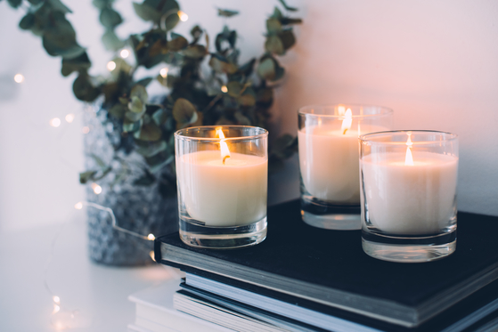 Three decorative candles burning