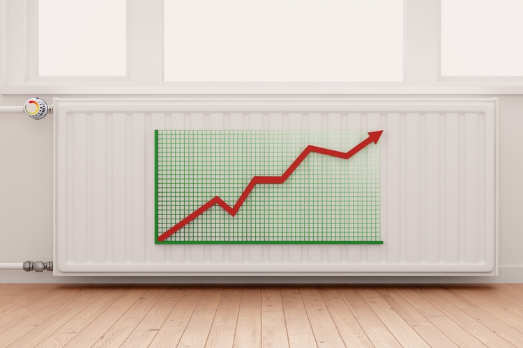 Ascending arrow graph on a heating radiator showing conceptual the increasing costs of energy.