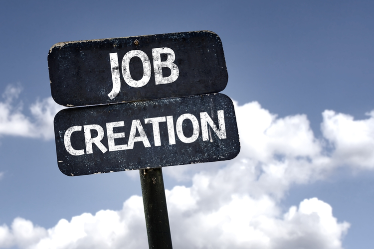 Job Creation sign with clouds and sky background.