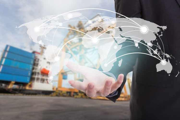 Man holding graphic of worldwide supply chain in palm