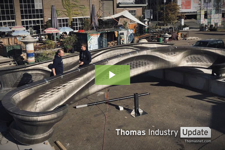 Pedestrians Cross Futuristic 3D-Printed Bridge for the First Time