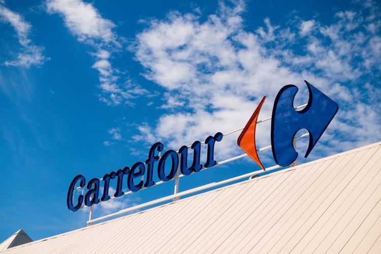 Carrefour signage against sky
