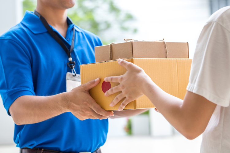 Delivery worker handing packages to customer