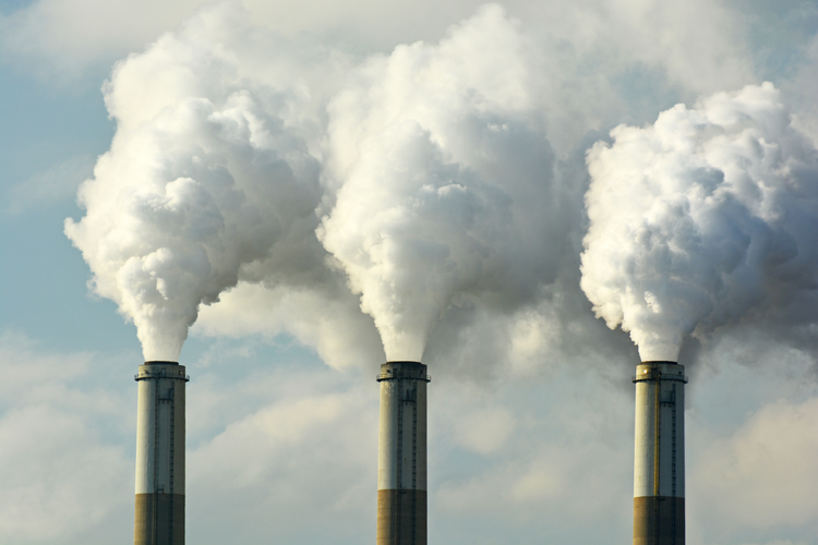 Coal fossil fuel power plant smokestacks emitting carbon dioxide pollution.