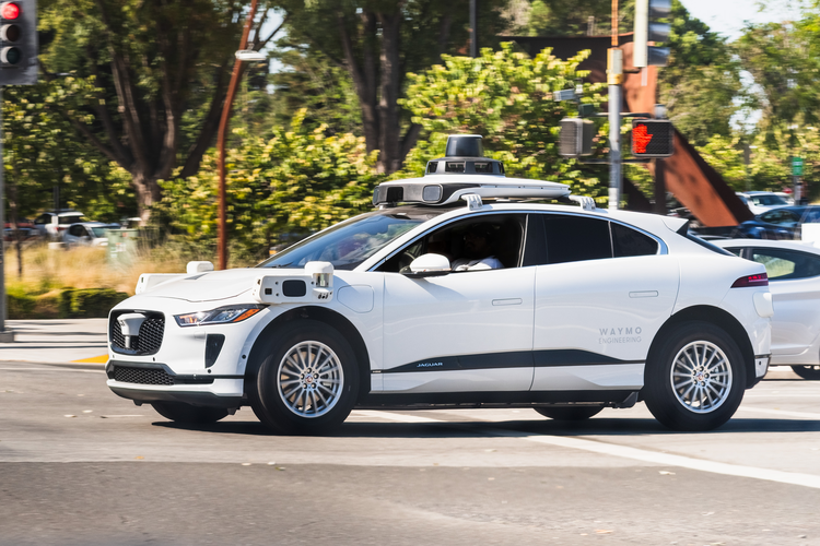 Waymo, Google's self-driving car research, is driving on the road.