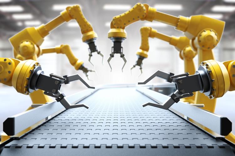 Robotic arms and conveyor belt.