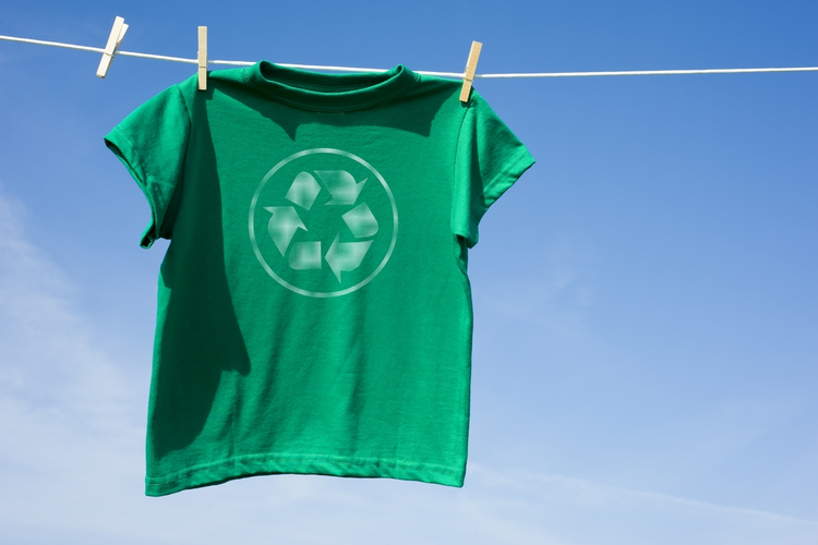T-Shirt with recycling symbol hanging on line with clothespins.