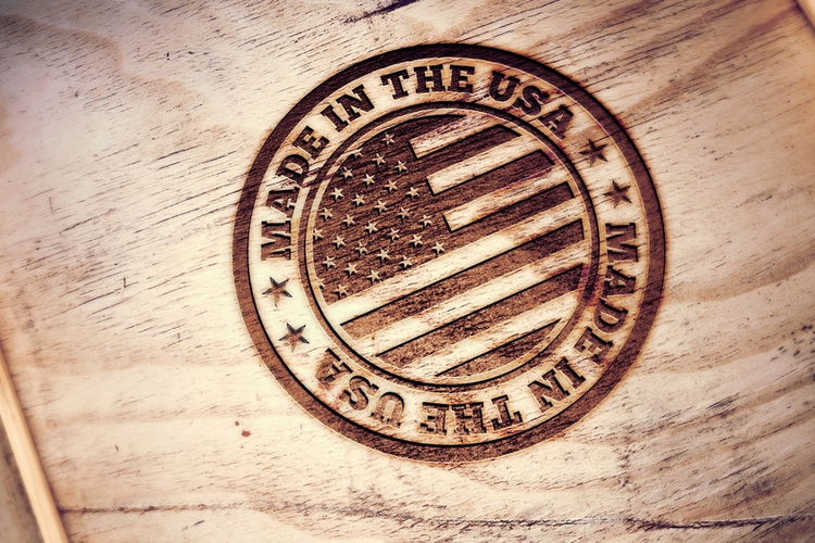 Made in USA symbol engraved on wooden box.