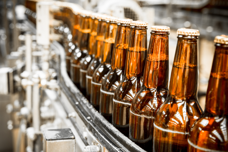 Beer bottles on conveyor belt.