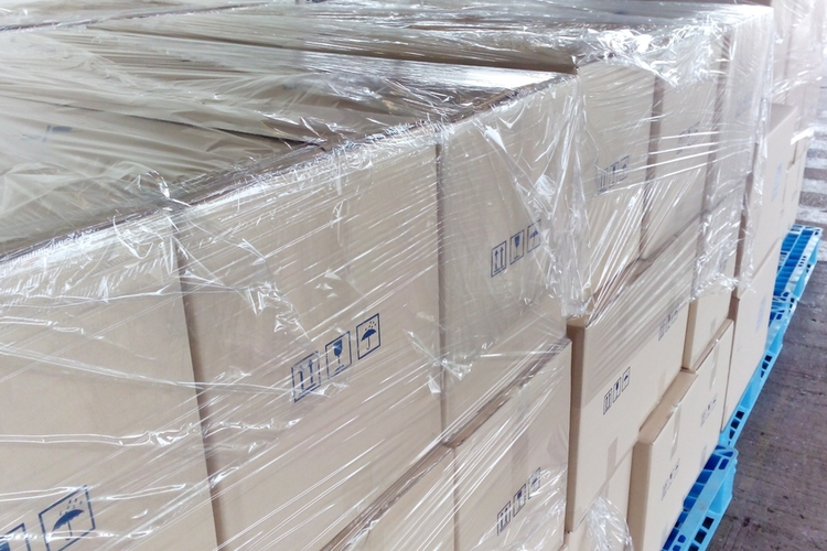 Shrink wrapped shipping boxes.