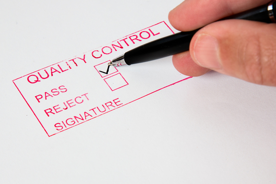 Quality control sheet with stamped approval