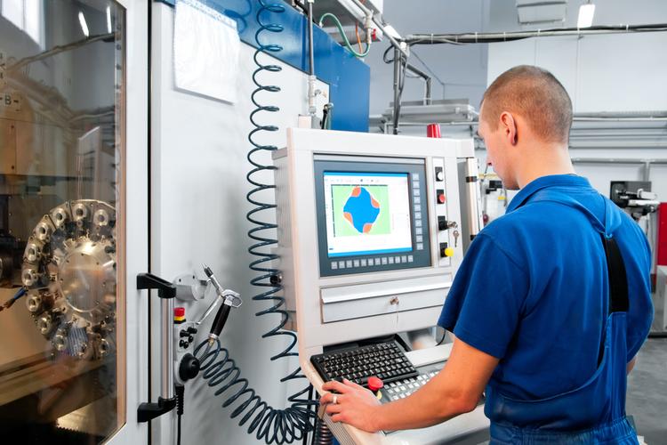 Man operating a CNC machine.