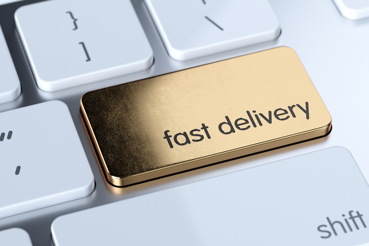 Golden fast delivery sign button on white computer keyboard.