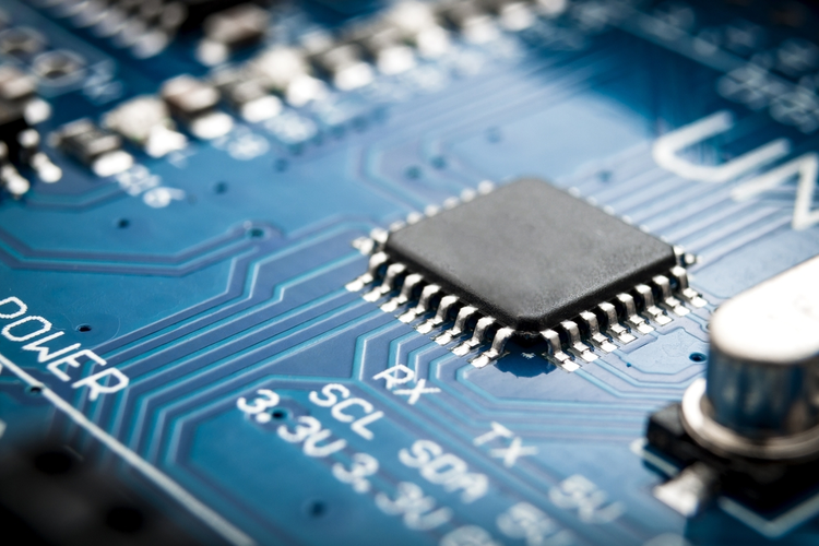 Integrated semiconductor microchip/microprocessor on blue circuit board.